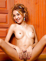 Skinny Asian shemale Ammy posing naked in high heels and spreading