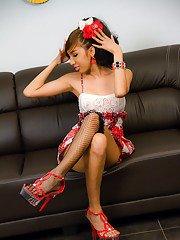 Pretty Asian shemale Pinky poses solo in hot stockings and high heels