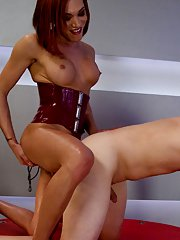 Charming BDSM tranny Mia Isabella dominating a man in her latex suit
