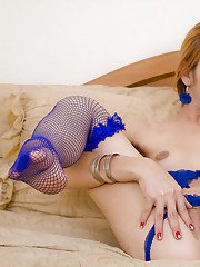 Horny blonde Asian ladyboy Lisa fingering her pussy in blue stockings