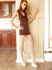 Skinny redhead Thai tranny Ally bending over and spreading in heels