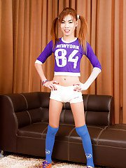 Cute redhead Ladyboy Pink strikes sexy solo poses in long socks and panties