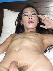 Petite Thai shemale jerking off her hairy dick and posing in her room