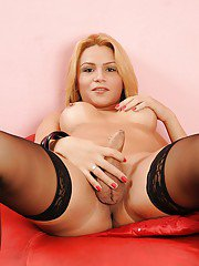 Nasty blonde tranny Viviane Rios getting her ass fucked in stockings