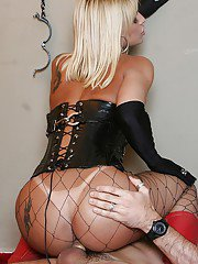 Busty Blonde tranny Carla Renata getting her dick sucked in pantyhose