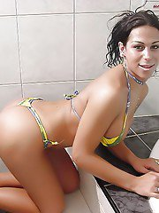 Busty Latina transsexuals remove bikinis for sexy shower fun