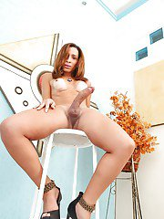 Latina TS Gabrielli Bianco strips and shows off her big ass and cock