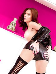 Kinky Asian tranny Kate posing in a hot leather cat woman outfit