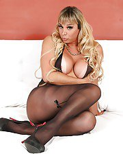 Busty Latina shemale in pantyhose and heels barebacks mans butthole