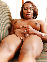 Chubby ebony transsexual Honey lubing big tits and dick for massturbation