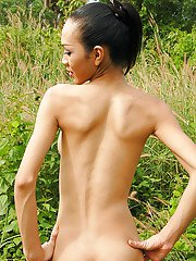 Skinny Asian ladyboy Deer showing off big tits and tight ass outdoors