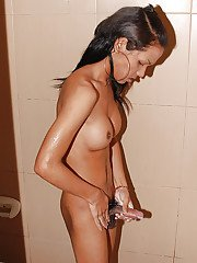 Skinny Asian solo ladyboy Gobee flaunting big tits and hairy cock in shower