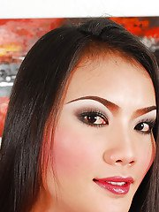 Pretty solo Asian ladyboy Tutka jerking off to cumshot in long boots