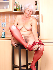 Naughty Anilos granny takes off her panties and stimulates her experienced gray haired