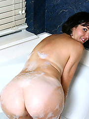 Alluring cougar Katie fucks her sweet pink pussy with a clear glass dildo in the
