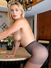 Big titted Tanya Tate slips off her evening wear and fingers her shaved Anilos pussy