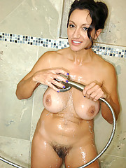 Totally naked busty milf stuffs her hairy Anilos pussy with a rabbit toy inside the