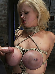 Katie Cox and her huge tits are bound and a cock is jammed down her throat. Tight