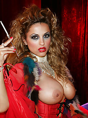 Big boob curly hair smoking babe in red lingerie masturbates