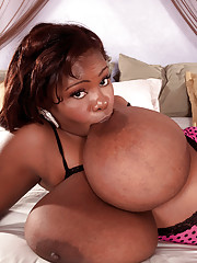 Saucy black BBW with big black boobs strips and fingers her twat