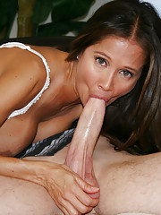 HotWifeRio puts on a pair of white stockings and sucks off a huge cock