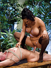 FemDom Isis Love gives slave a dose of CBT amp CFNM by kicking his balls with her