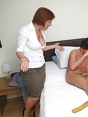 Inexperienced girl is given a handjob lesson by two MILFs using her boyfriend