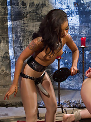 Skinny black girl punishes her naughty slave in the dungeon