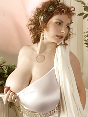 Solo model Christy Marks poses in a toga before baring massive boobs