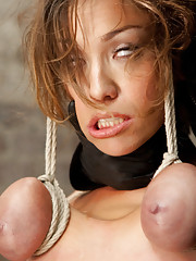 Beautiful Audrey is subjected to intense bondage predicaments partial breast suspension
