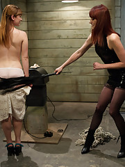 Cute redhead dominated by fierce redheaded lesbian dominatrix whipping her to orgasm