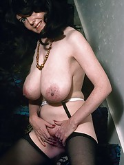 Classic chick with natural big boobs posing and masturbating