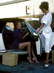 Sexy retro lesbian lovers giving each other a helping hand
