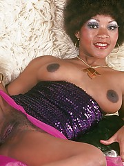 Retro ebony spreads her legs and shows her pussy and her ass