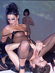 Amazing brunette learns how to suck cocks in fetish academy