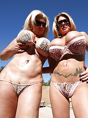 Double team of sluts with gigantic luscious tits!