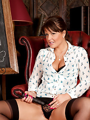 Naughty teacher Elle Brook stuffs a black dong in her pussy
