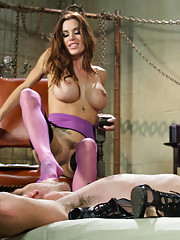 Mistress Gia Dimarco fucks new meat in the ass while hes suspended and puts him in
