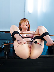 Redheaded Electroslut is bound with electrified copper pipes and then DPed with the