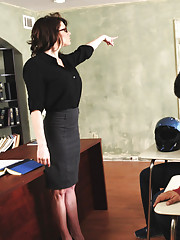 Busty brunette teacher Dallas punishes one student and decides to fuck the other
