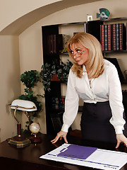 Busty blonde teacher seduces her big cocked student on her desk for hot sex.