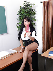 Holly Halston pulls out her big double sided dildo to show her student. Then she