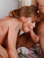 Hot mom Darla Crane is horny and ready to suck and fuck two big cocks at the same