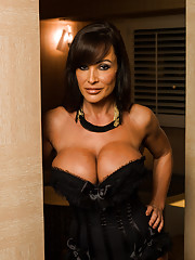 Gorgeous busty Lisa Ann plays with a toy for her client and then fucks him.