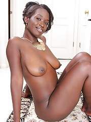 Classy ebony babe Sayanna Monroe undresses and spreads her black pussy