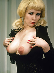 Blonde girl with boobs and classy stockings showing it all