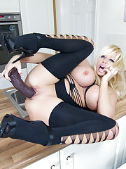 Filthy blonde slut Michelle Thorne stretches her long sexy legs on the kitchen table