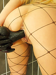 Blonde babe Michelle Thorne takes a hot shower in her tiny fishnet outfit and her