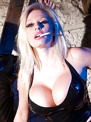 Mistress Thorne is in the dungeon dressed in some very tight black latex. She has