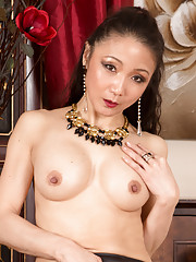 Sexy Asian housewife Kim plays with her perky tits and smooth shaved twat